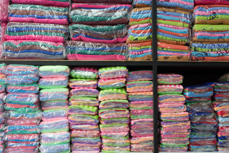 softness: warehouse of towel softness fluffy fiber fabric on shelf for sale, industrial of textile Stock Photo