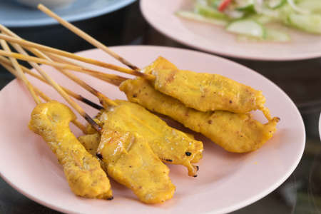 stringed: thai food, baked stringed meat on wood stick