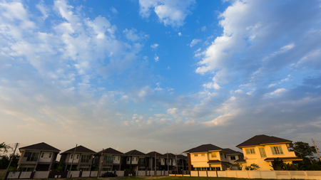 real estate industry: beautiful blue sky and clouds with residential house of village, property real estate industry background Stock Photo