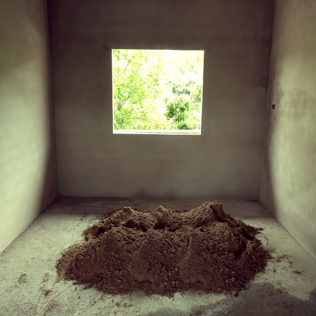 pile dwelling: pile sand in construction site prepared mix cement concrete for plaster wall and floor, image used filter vintage