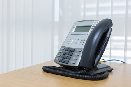 telephone receiver: telephone on table work of room service business office Stock Photo