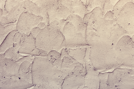 plasterwork: plaster mortar wall of industrial building construction, rough cement wall texture background, image used filter vintage