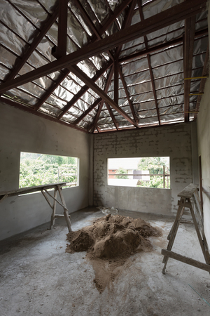 housebuilding: residential building construction site with cement concrete wall and roof steel beam Stock Photo