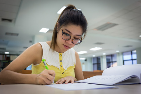 write: study education, woman writing on a paper, working women