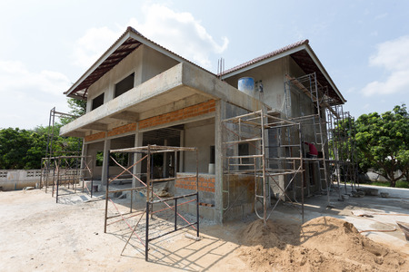 building residential construction house with scaffold steel for construction worker