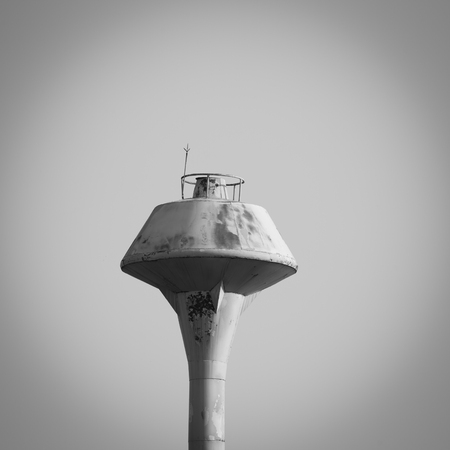 empty tank: old yellow water tank tower on empty sky