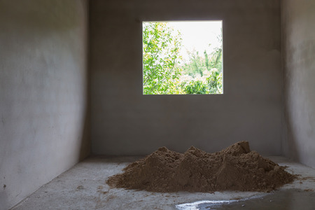 pile dwelling: pile sand in construction site prepared mix cement concrete for plaster wall and floor