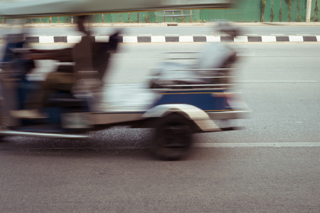 chiangmai: tuktuk car fast motion blurred driving on road, chiangmai, thailand Stock Photo