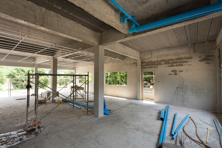 dwelling: construction site building with cement material structure Stock Photo