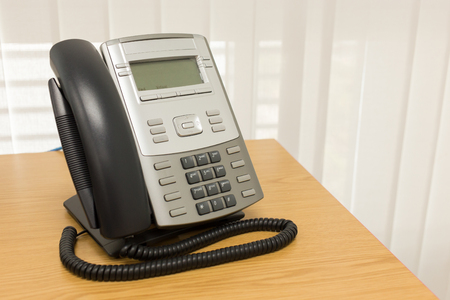 telephone handset: telephone on table work of room service business office Stock Photo