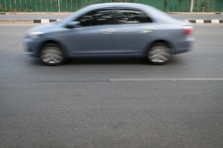 overtake: car fast motion blurred driving on road