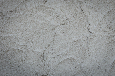 plasterwork: plaster mortar wall of industrial building construction, rough cement wall texture background