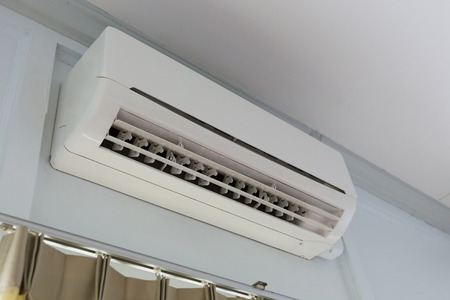 micro climate: cool air conditioner system on white wall room Stock Photo