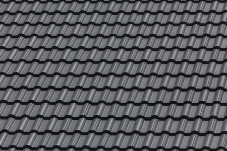 residence: black tile roof on building residence house