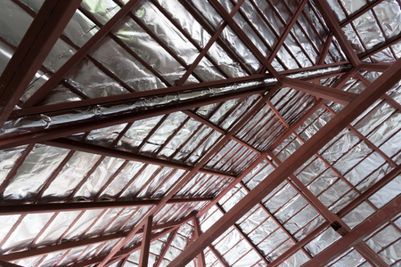 steel beam: roof with steel beam and silver foil insulation heat on ceiling roof house