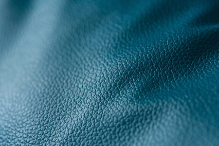 leatherette: leatherette of pillow decorated on sofa furniture, close up image Stock Photo