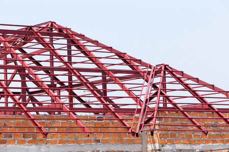 roof framework: structural steel beam on roof of building residential construction Stock Photo