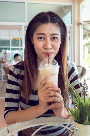 frappe: happy women drinking frappe coffee in cafe Stock Photo
