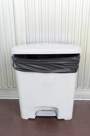 worthless: black bag plastic in white trashcan bin
