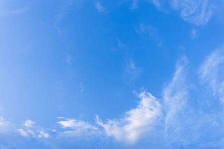 blows: wind blows clouds in blue sky background Stock Photo