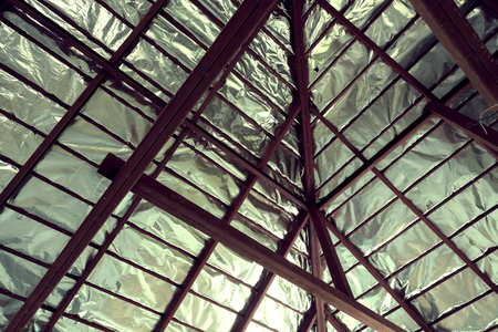 roof beam: roof with steel beam and silver foil insulation heat on ceiling roof house, image used filter vintage