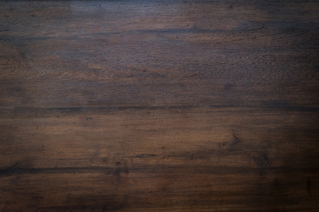 table: wood brown grain texture, dark wood wall background, top view of wooden table Stock Photo