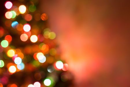 winter decorations: christmas background, image blur colorful bokeh defocused lights decoration on christmas tree Stock Photo