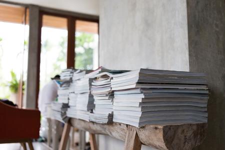 magazine stack: design of interior living room, stack of magazine books on wooden table shelf Stock Photo