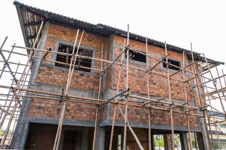 residential construction: building residential construction house with scaffold for construction worker Stock Photo