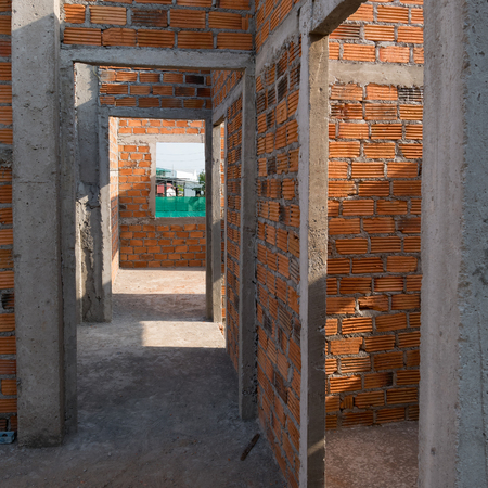 residential building: wall made brick in residential building construction site