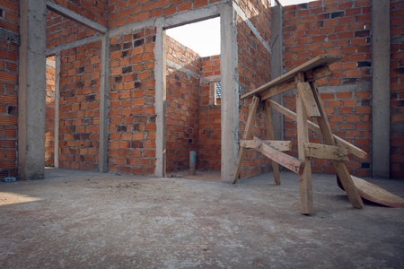 construction house: wall made brick in residential building construction site