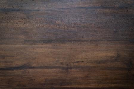 wood brown grain texture, dark wood wall background, top view of wooden table Foto de archivo