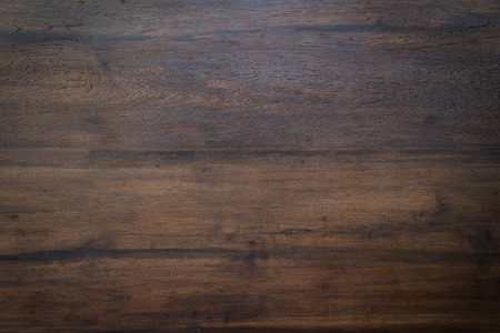 wooden surface: wood brown grain texture, dark wood wall background, top view of wooden table Stock Photo