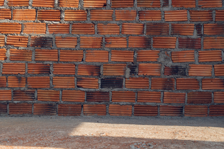 residential construction: wall made brick in residential building construction site