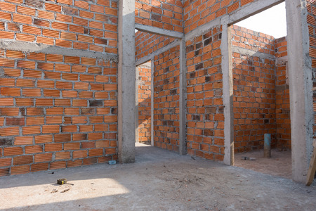 housebuilding: wall made brick in residential building construction site