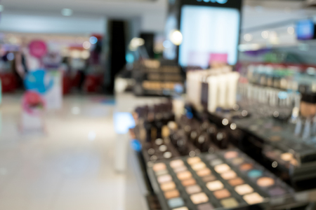 make up fashion: sets of makeup in department store shopping mall, image blur defocused background