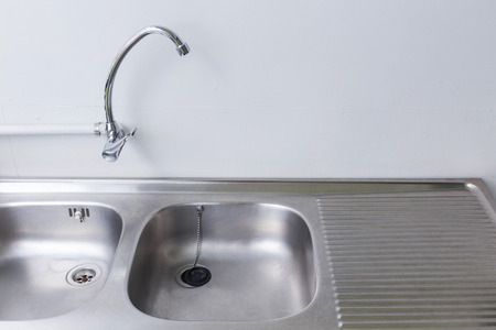 stainless steel sink: stainless steel sink and faucet in white kitchen room