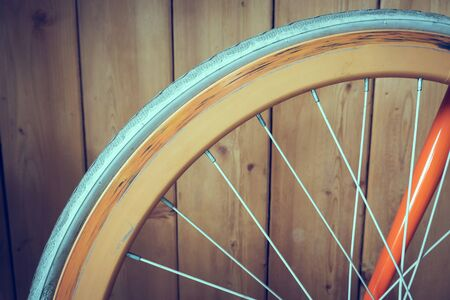 fixed: fixed gear bicycle parked with wood wall, close up image part of bicycle