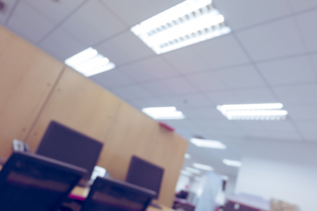 screen partition: abstract blur background table work in office with computer pc