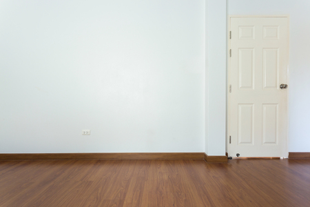blank empty: empty room with brown wood laminate floor and white mortar wall background