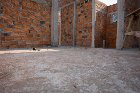 housebuilding: dirty cement floor in residential building construction site