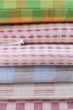 hassock: heap of cloth fabric in retail shop Stock Photo