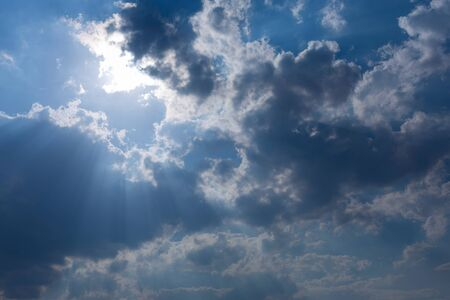 through: sunbeam through the clouds of sunlight in blue sky background