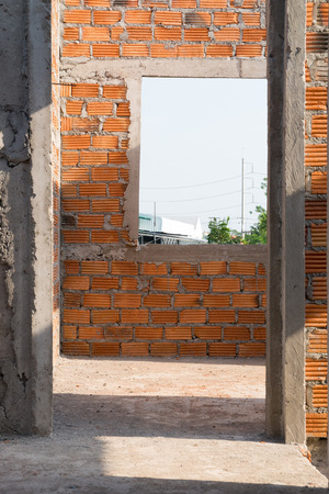 housebuilding: wall made brick and door structure in residential building construction site