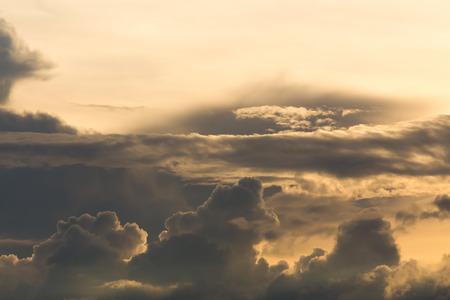 moody sky: beautiful sunset sky, golden light of sun on dramatic moody sky