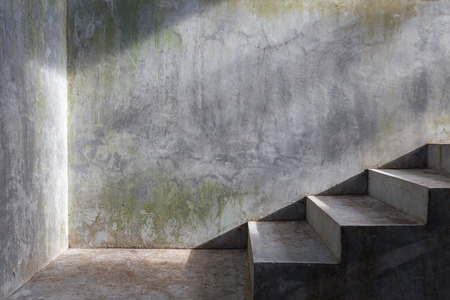crack climb: cement concrete staircase with sunshine on mortar wall background