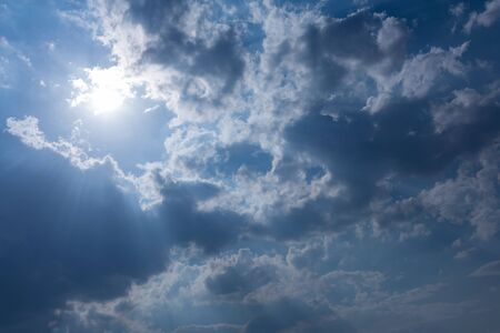 moody sky: sunbeam through the clouds of sunlight in blue sky background