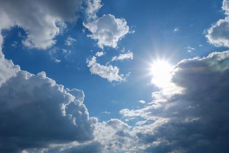 clear weather sky, sun on blue sky with clouds, sun rays, solar of clean energy power