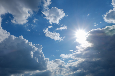clear weather sky, sun on blue sky with clouds, sun rays, solar of clean energy power