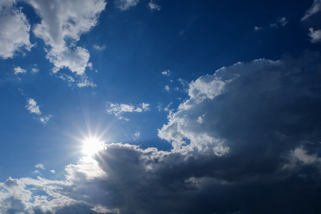 clean energy: clear weather sky, sun on blue sky with clouds, sun rays, solar of clean energy power